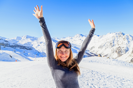Happy woman enjoying the winter holiday in the Alps Stock Photo - 26901699