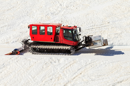 groomer: Photo of red snowcat transport food in the mountains
