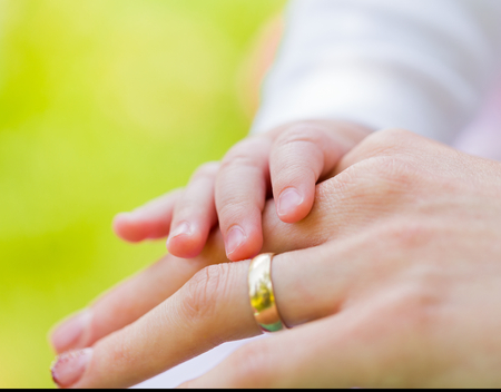 nursling: Closeup photo of mother and baby hands