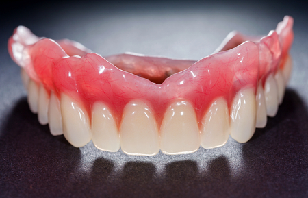 The artificial denture on isolated  black