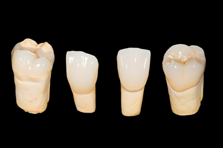 Dental ceramic crowns on isolated black