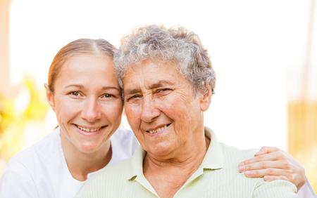 Closeup photo of elderly woman with the caretaker  photo