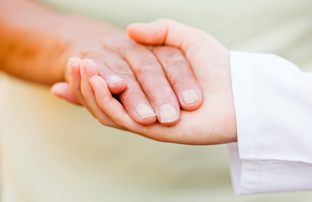 reassurance: Giving helping hands for needy elderly people Stock Photo