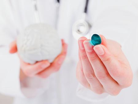 adjuvant: Closeup photo of blue gel capsule in doctor hand
