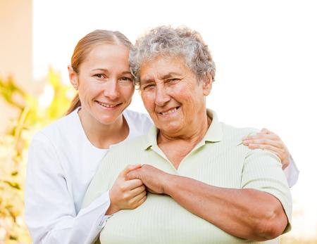 Closeup photo of elderly woman with the caretaker