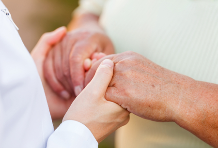 Giving helping hands for needy elderly people Stock Photo