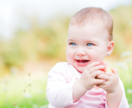 the infancy: Portrait of an adorable and cheerful baby girl