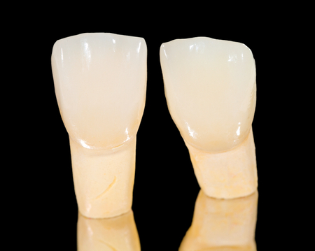 prosthodontics: Dental ceramic crowns on isolated black background Stock Photo