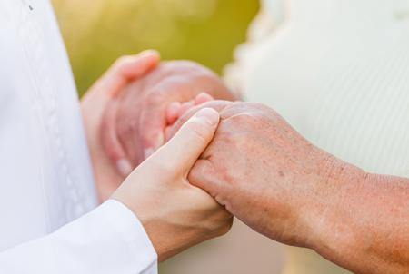 needy: Giving helping hands for needy elderly people Stock Photo