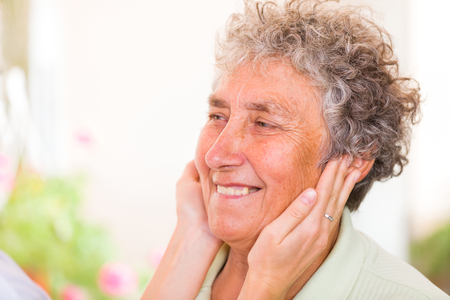 aide: Close up photo of a happy elderly woman Stock Photo