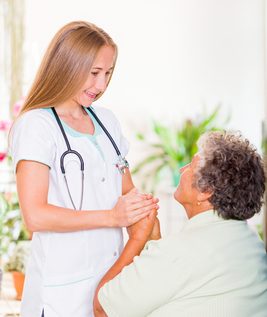 carers: Photo of elderly woman with the young doctor