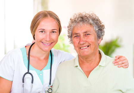 senior carers: Photo of happy elderly woman with the young doctor Stock Photo