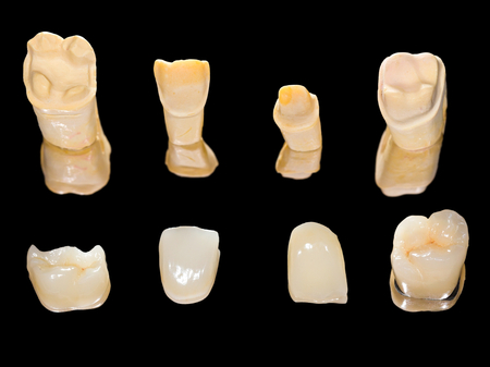 prosthodontics: Dental ceramic crowns on isolated black