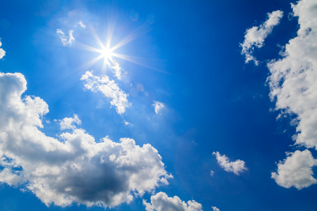 Sun and beautiful clouds on the blue sky Stock Photo