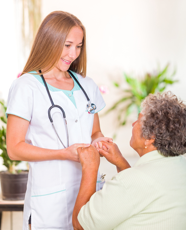 senior carers: Photo of elderly woman with the young doctor
