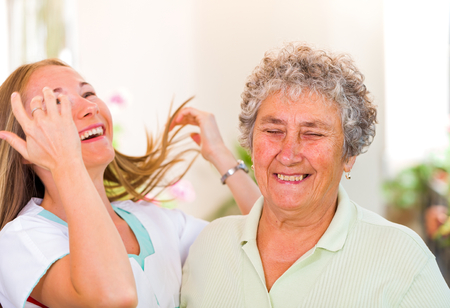 Snapshot of an elderly woman with her daughter having fun photo