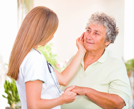caresses: Photo of happy elderly woman with the young doctor Stock Photo