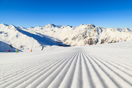 maintained: Closeup photo of a groomed ski slope in Alps Stock Photo