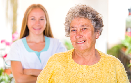carers: Photo of happy elderly woman with her caregiver