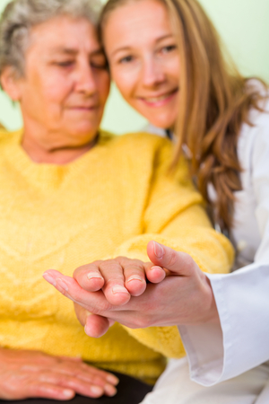 carers: Photo of elderly woman with her daughter Stock Photo