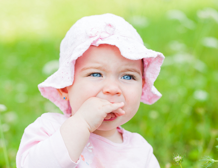 grouchy: Close up photo of an adorable baby girl