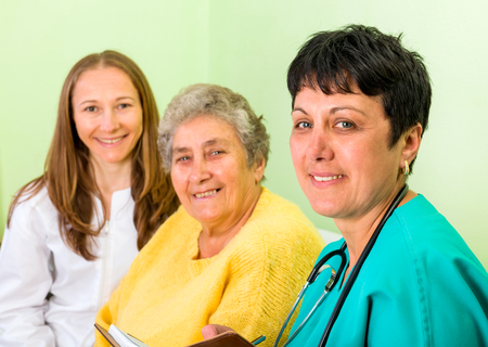 carers: Photo of happy elderly woman with her daughters