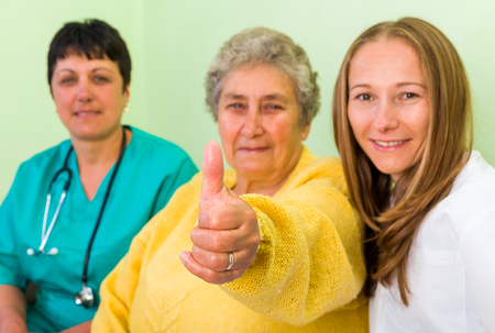 carers: Elderly woman with her carer and doctor