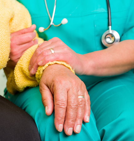 senior carers: Young doctor giving helping hands for elderly woman