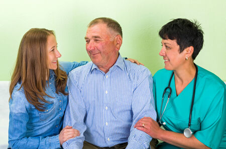senior carers: Photo of elderly man with his daughter and doctor Stock Photo