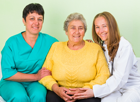 senior carers: Photo of happy elderly woman with her daughters