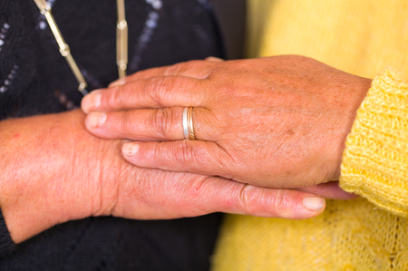 to reassure: Close up photo of elderly women hands Stock Photo
