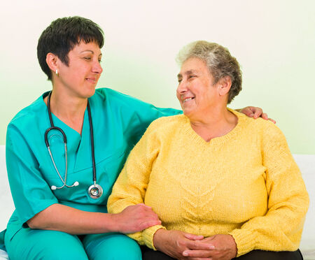 carers: Photo of elderly woman with the doctor