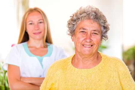 senior carers: Photo of happy elderly woman with her caregiver