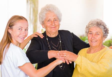 nursing association: Photo of elderly women with their carer Stock Photo