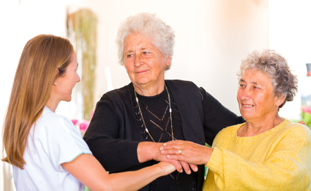 nursing associations: Photo of elderly women with their carer Stock Photo