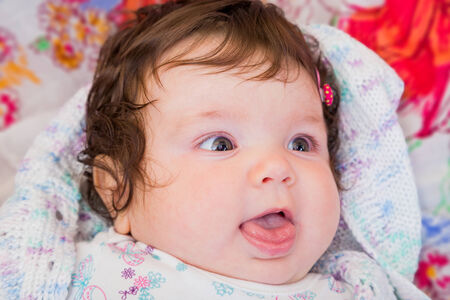nursling: Portrait of an adorable few months old baby