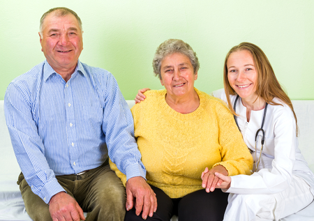 senior carers: Photo of happy elderly couple with the doctor