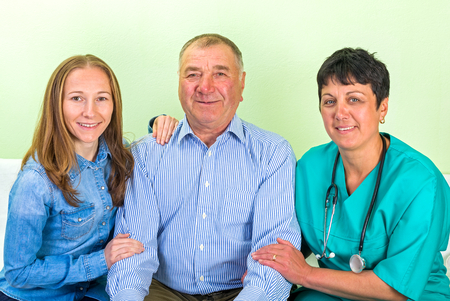 father daughter: Photo of elderly man with his daughter and doctor Stock Photo