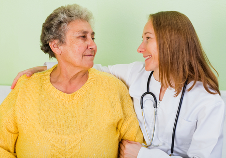 carers: Photo of happy elderly woman with her daughter