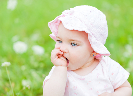 Portrait of an adorable baby girl in outside photo