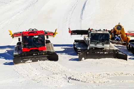 snow grooming machine: Photo of snow vehicles preparing ski slope