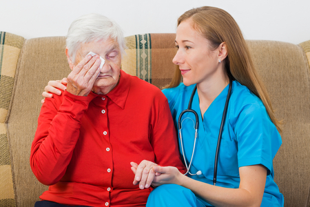 Photo of elderly woman with the young doctor photo