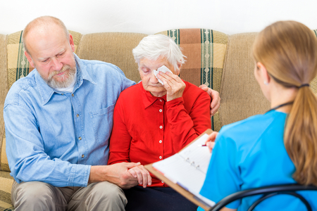 senior care: Photo of elderly woman tells a story for the doctor