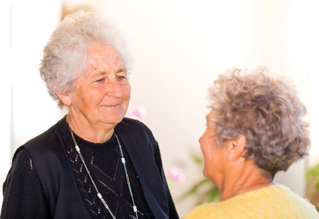 Photo of elderly women smiling to the camera Stock Photo