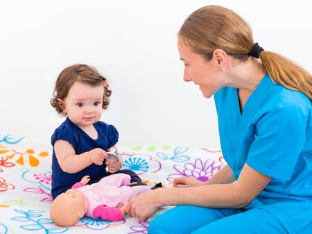 Photo of an adorable baby and the doctor Stock Photo