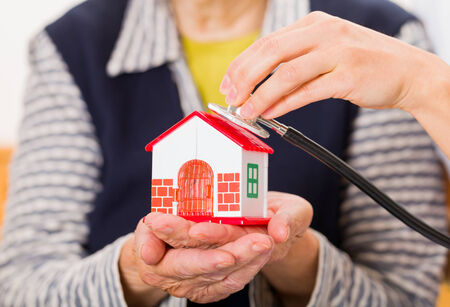homecare: Photo of a miniature house holding in hands