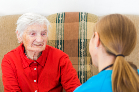 tells: Photo of elderly woman tells a story for the doctor
