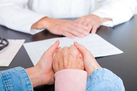 carer: Elderly woman hands supported by carer hands