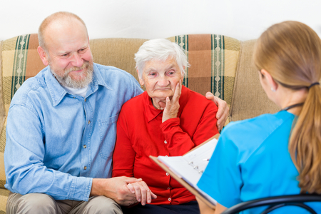 Photo of elderly woman tells a story for the doctor photo