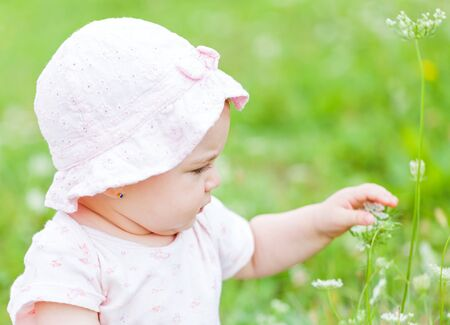 newness: Portrait of an adorable baby girl in outside